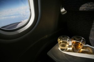 drinking-on-airplane-080610-xlg